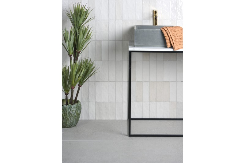 while wall tile with table infront